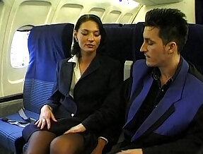 Brunette beauty wearing stewardess uniform gets deep anal fucked on a plane