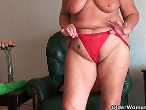 Chubby granny with saggy tits and plump ass spreads her pussy